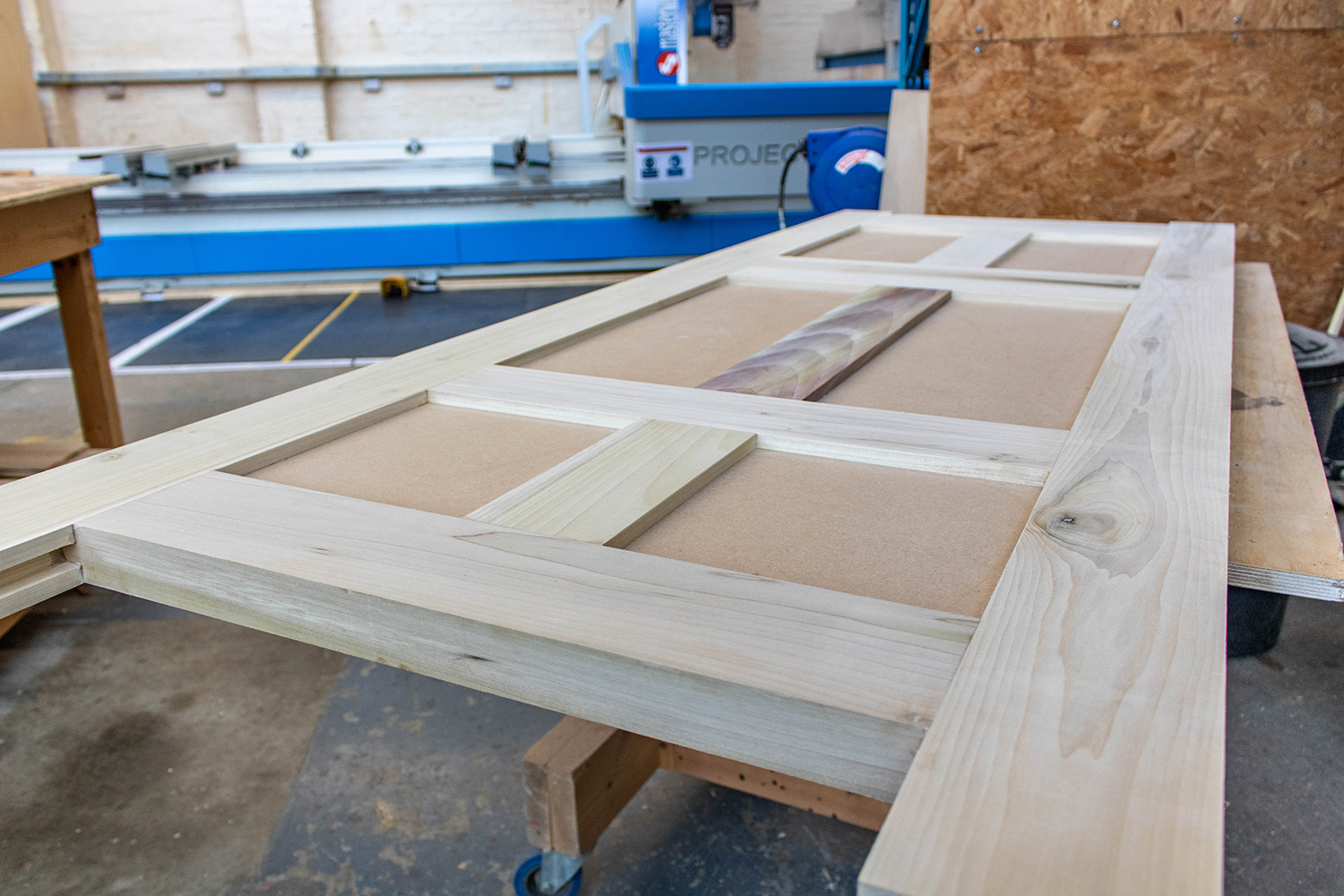 Construction of a wood door in joinery workshop