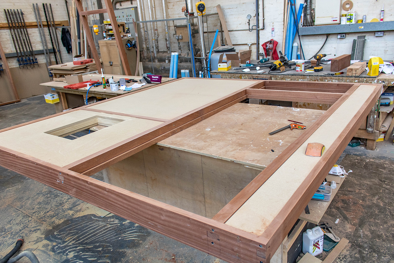 Expanded door frame construction in joinery workshop