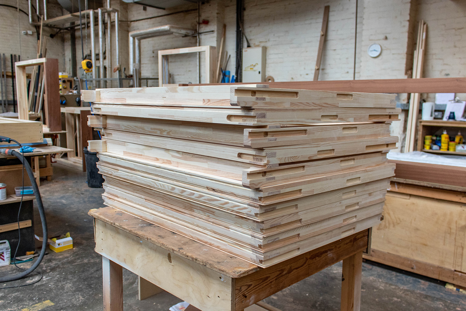 Stack of wood frames in joinery workshop