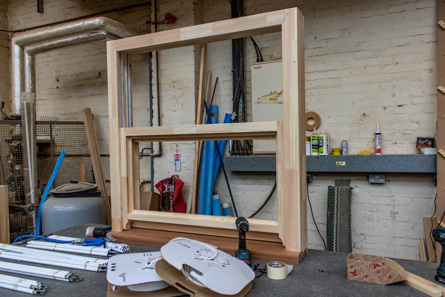 Double panel window with wood frame being built in K&D's workshop