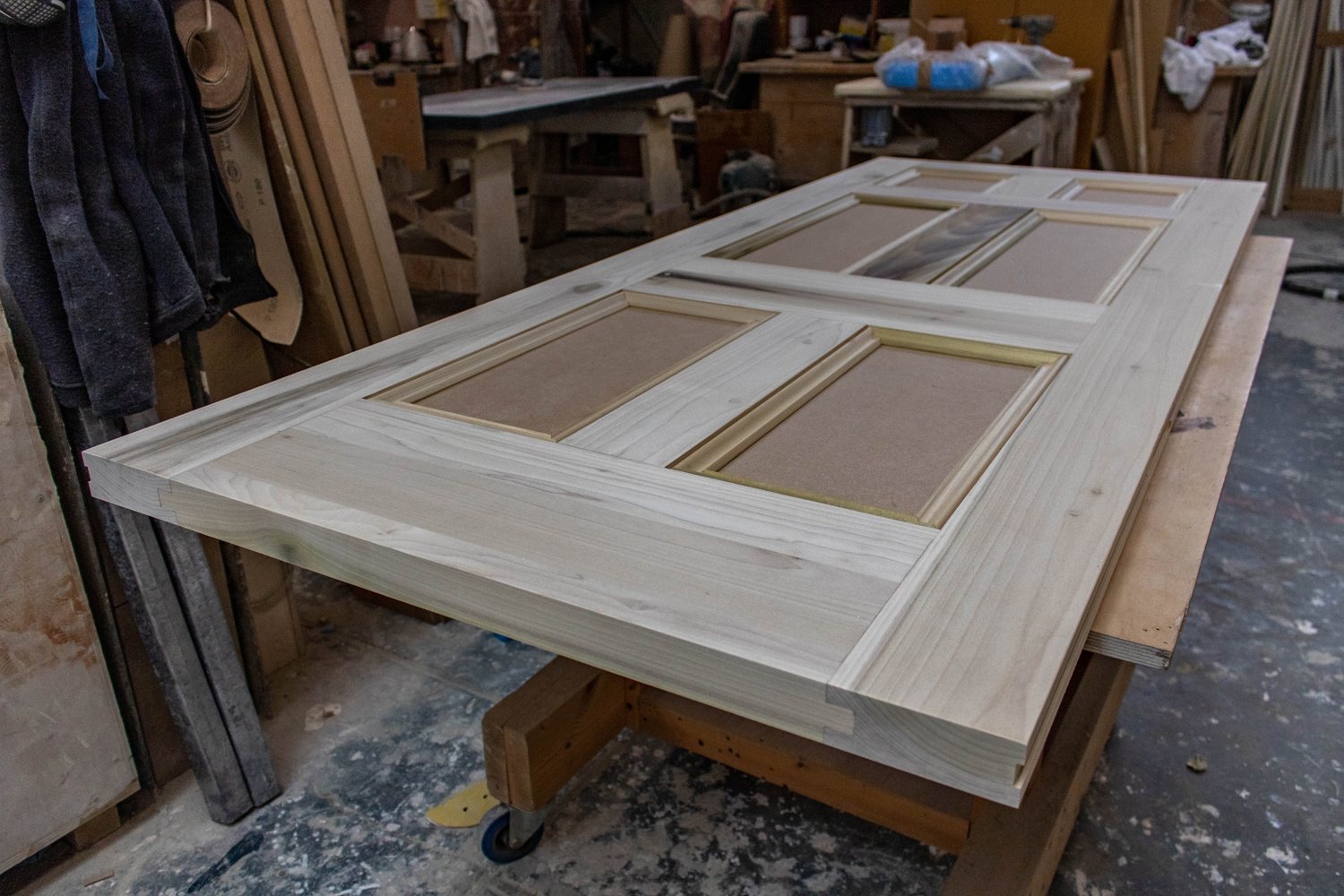 wood door being constructed in joinery workshop
