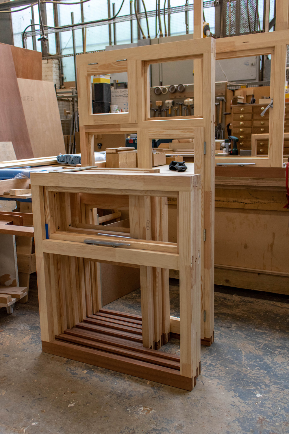 set of bare wood window frames