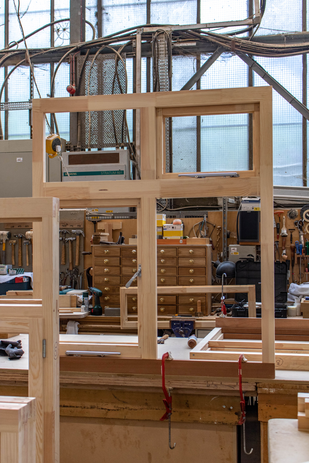 wooden window frame being built in workshop