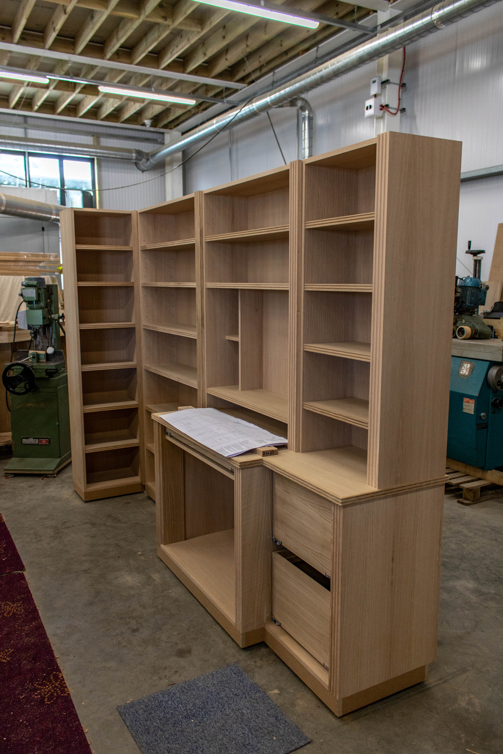 wooden set of shelves and cabinetry in workshop