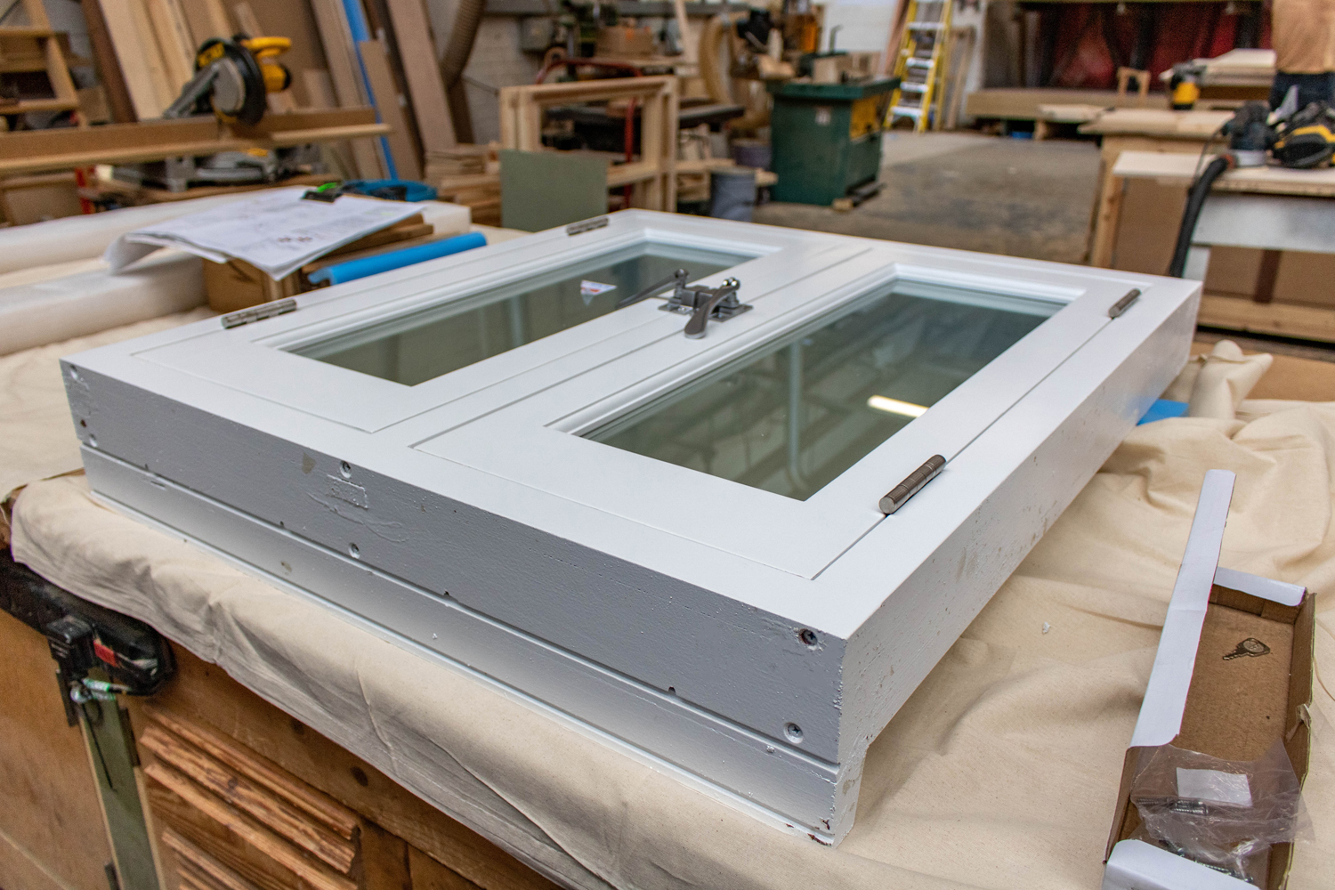 small white window unit in k&d joinery workshop