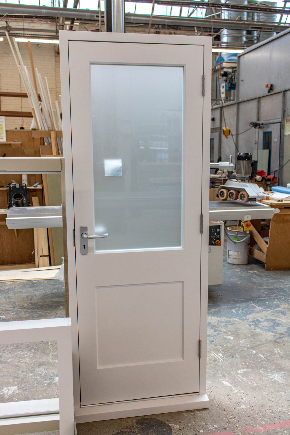 white door with frosted glass panel in k&d joinery workshop london