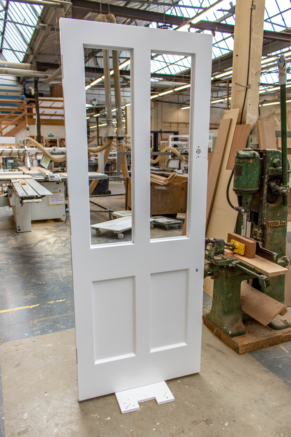white door with empty glass panels in k&d joinery workshop