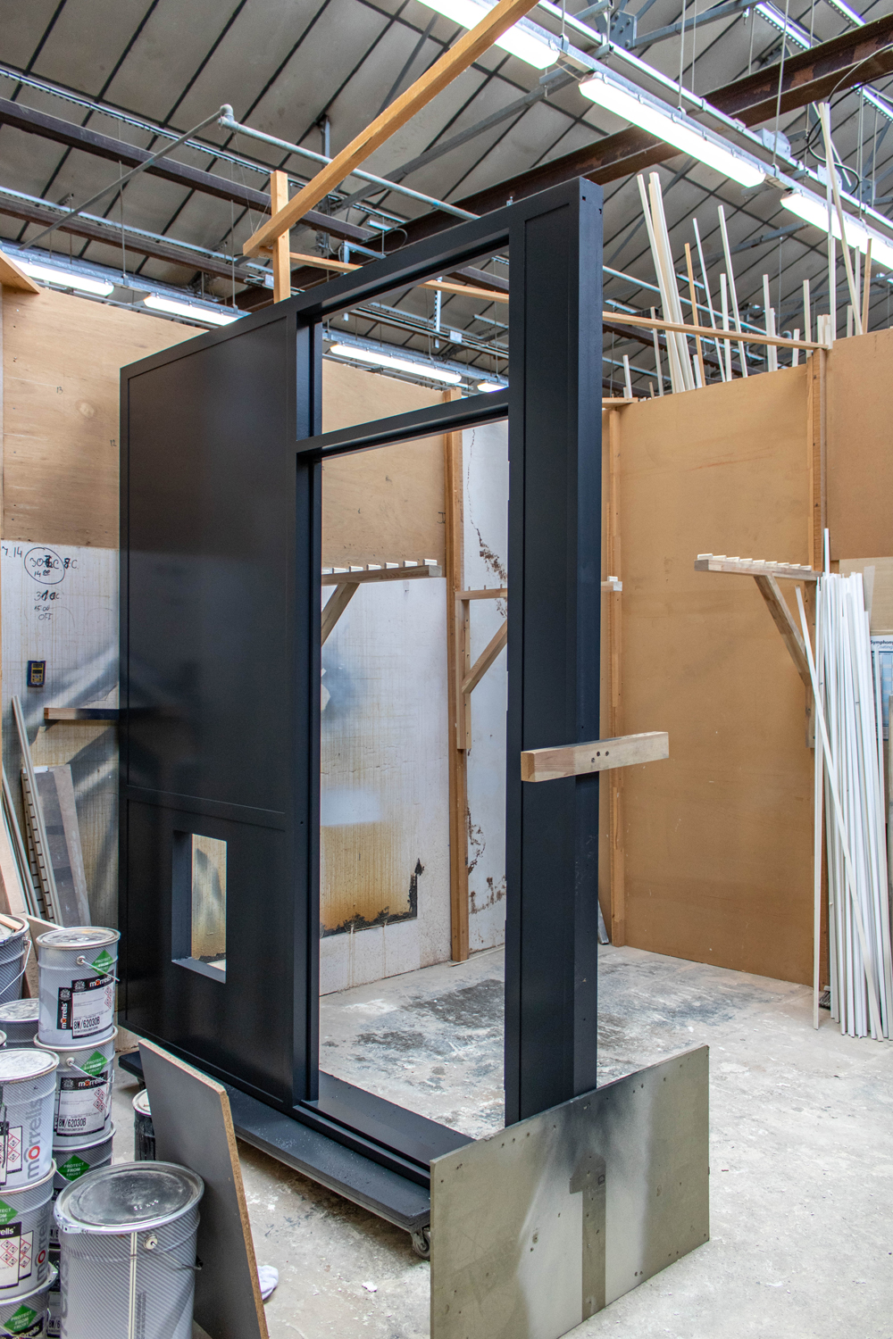 black door frame in k&d joinery workshop london