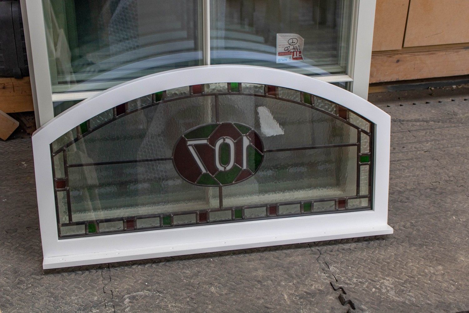 red and green stained glass fanlight with house number