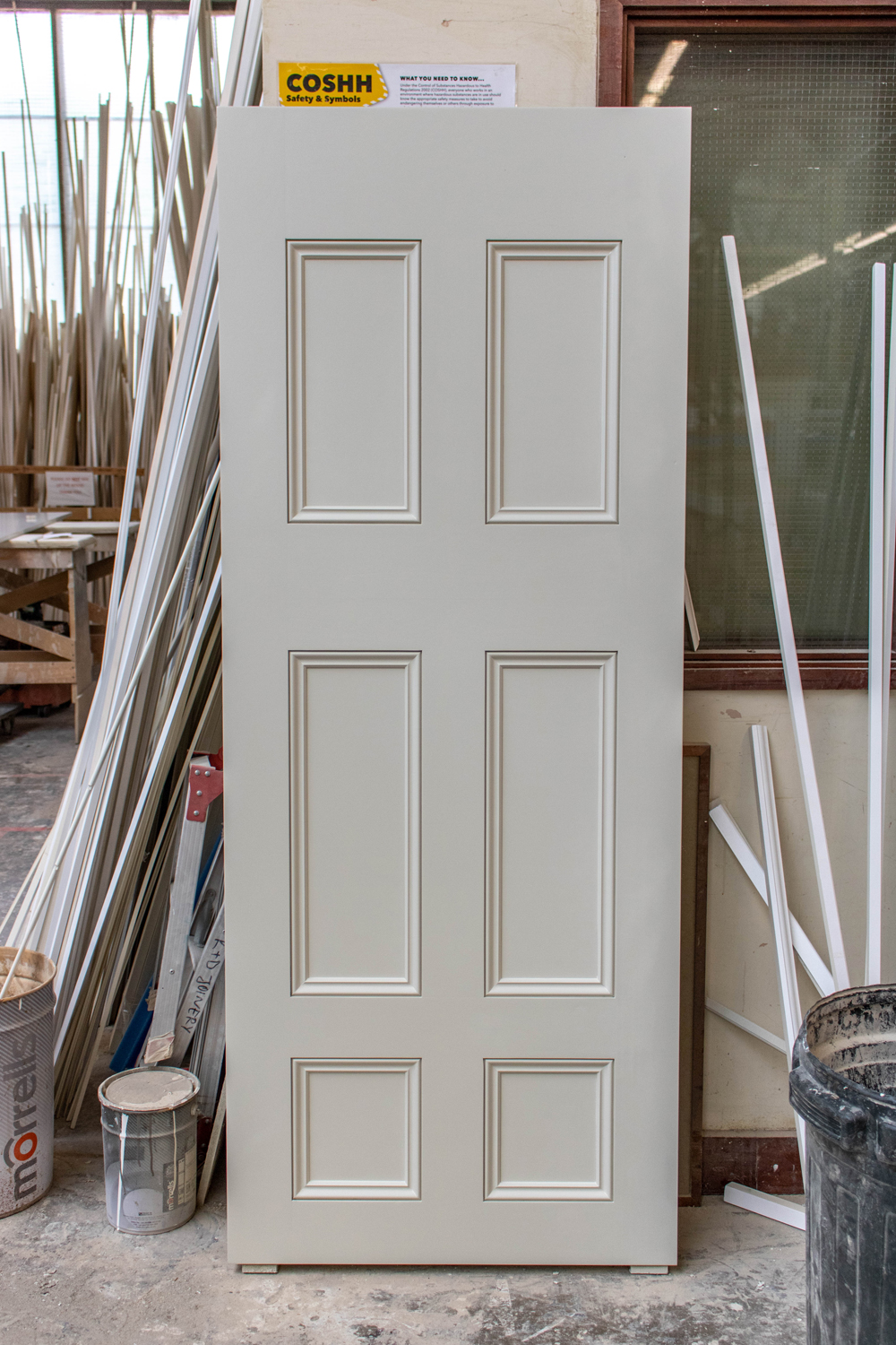 white internal door in k&d joinery workshop