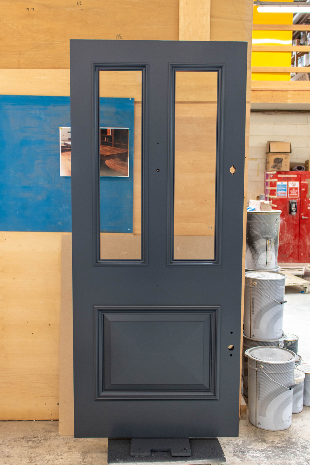 grey door in k&d joinery workshop