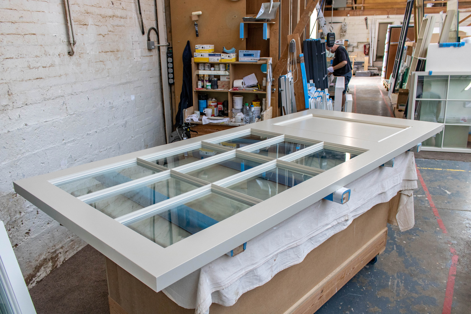 white glass panelled door in k&d joinery workshop